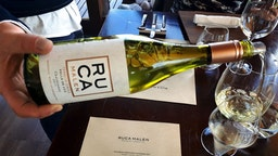 Bodega Ruca Malen's Terroir series Chardonnay 2017 vintage is served at the start of a seven-course tasting menu at the winery's restaurant on March 28, 2019 in the Luj√°n de Cuyo district of Mendoza province, Argentina. Ruca Malen winery was established in 1998 and opened its on-site gourmet restaurant in 2004, surrounded by vineyards and with a view of the nearby Andes mountains. Under head chef Lucas Bustos, the restaurant's menu is dedicated to locally sourced produce and pairs every course with a different Ruca Malen wine. According to government data, increasing numbers of foreign tourists are flocking to the iconic wine-producing province of Mendoza and its award-winning wineries attracted by a cheaper devalued Peso and acclaimed wines at bargain prices in the wake of Argentina's latest economic meltdown. (Photo by David Silverman/Getty Images)