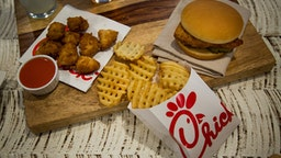 Chicken nuggets, french fries, and a fried chicken sandwich are arranged for a photograph during an event ahead of the grand opening for a Chick-fil-A restaurant in New York, U.S., on Friday, Oct. 2, 2015. Chick-fil-A, the Southern chicken-sandwich chain that has drawn both controversy and copycats over the years, has finally arrived in New York. The company will open a 5,000-square-foot (465-square-meter), three-level restaurant in Manhattan's Garment District that will be the chain's largest location in the nation.