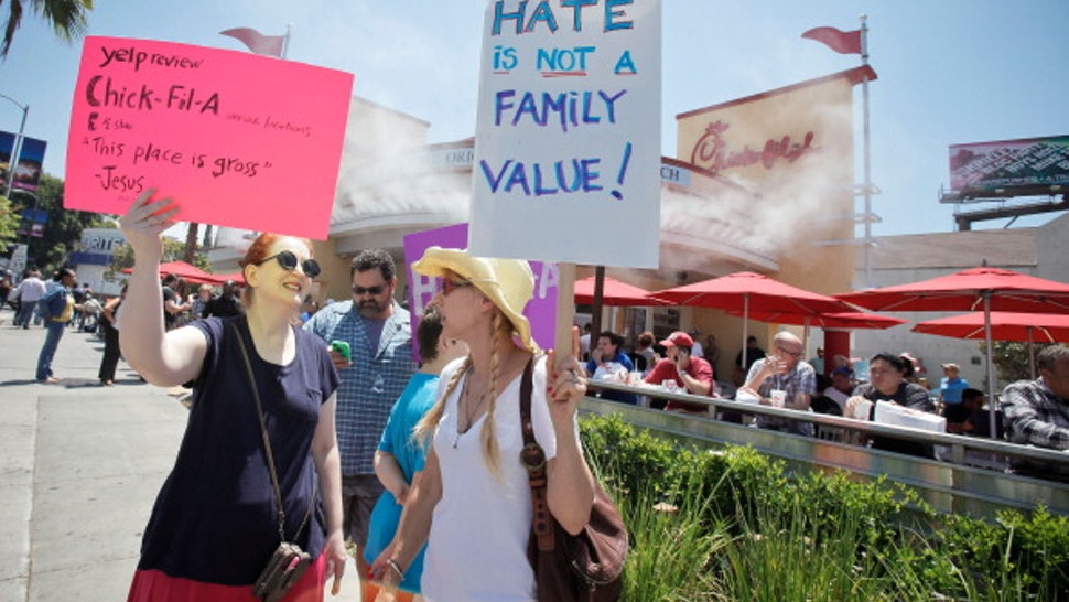 HOLLYWOOD, CA - AUGUST 01: (L-R) Jane Wilson and actress Kris McGaha attend the 'Chick-Fil-A Is Anti-Gay!' PETA and LGBT community protest at Chick-fil-A on August 1, 2012 in Hollywood, California.