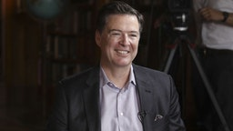 """James Comey, former director of the Federal Bureau of Investigation (FBI), reacts during a Bloomberg Television interview in Salzburg, Austria, on Friday, June 21, 2019. Comeysaid he hopes PresidentDonald Trumpisn't impeached because """"that would let the American people off the hook."""""""