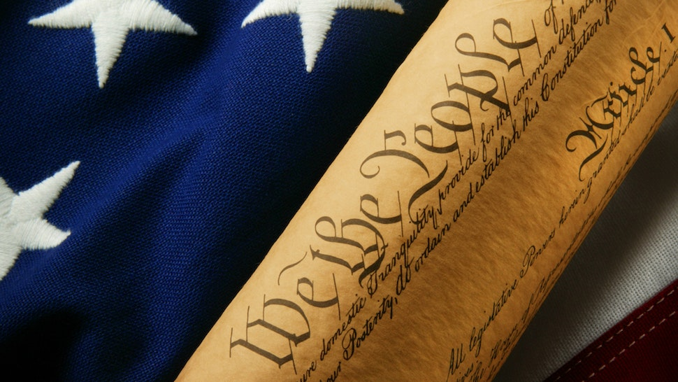 Copy of the United States Constitution on American flag.