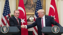 US President Donald Trump (R) shakes hands with President of Turkey Recep Tayyip Erdogan (L) in the Roosevelt Room where they issued a joint statement following their meeting at the White House on May 16, 2017 in Washington, DC.
