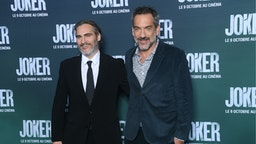 """Actor Joaquin Phoenix and Director Todd Phillips attend the """"Joker"""" Premiere at cinema UGC Normandie son September 23, 2019 in Paris, France."""