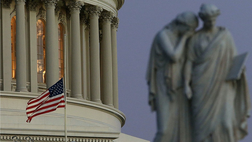 A flag at the U.S. Capitol flies at half staff after President Barack Obama ordered the action while speaking on the shootings at the Sandy Hook Elementary School December 14, 2012 in Washington, DC.