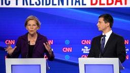 Sen. Elizabeth Warren speaks as South Bend, Indiana Mayor Pete Buttigieg looks on during the Democratic Presidential Debate