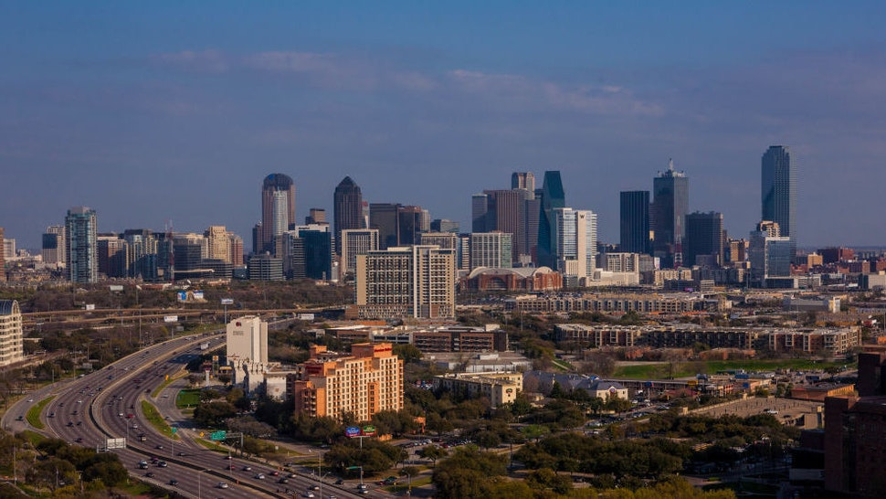 The downtown skyline is viewed from the Renaissance Hotel off Stemmons Highway on March 20, 2013 in Dallas, Texas. Dallas, a major hub of technology, energy, medical research, and commerce, is the fourth largest metropolitan center in the United States. (Photo by George Rose/Getty Images)
