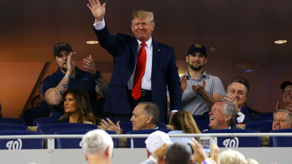 President Donald Trump acknowledges the crowd during Game 5 of the 2019 World Series
