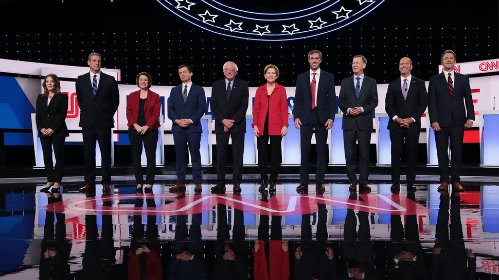 Democratic presidential candidates take the stage at the beginning of the Democratic Presidential Debate at the Fox Theatre July 30, 2019 in Detroit, Michigan.