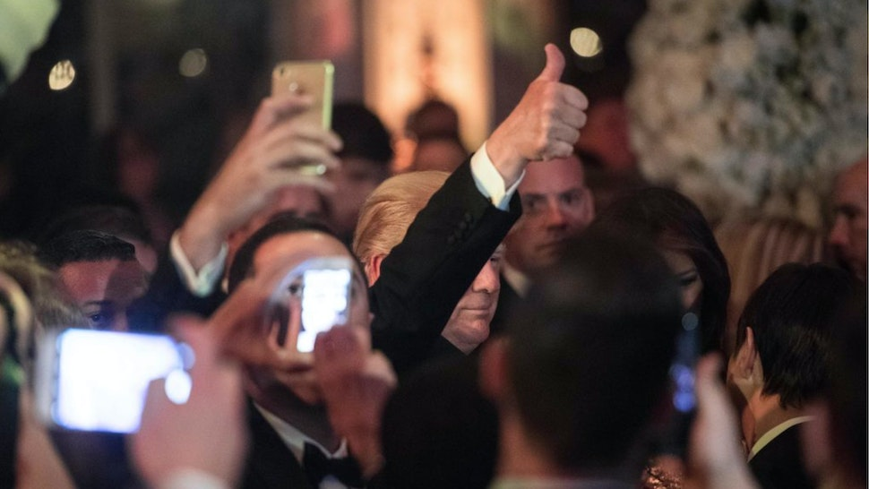 US President Donald Trump arrives at a new year's party at Trump's Mar-a-Lago resort in Palm Beach, Florida, on December 31, 2017.