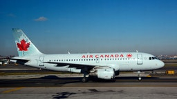 An Air Canada Express passenger jet lands at LaGuardia Airport in New York, New York.