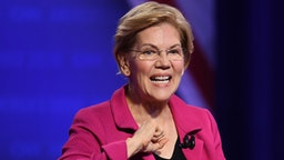 Democratic presidential hopeful Massachusetts Senator Elizabeth Warren gestures as she arrives for a town hall devoted to LGBTQ issues hosted by CNN and the Human rights Campaign Foundation at The Novo in Los Angeles on October 10, 2019.