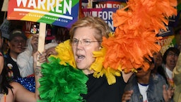 Democratic presidential candidate and U.S. Sen. Elizabeth Warren (D-MA) (R) marches with supporters in the Southern Nevada Association of Pride Inc. 22nd annual PRIDE Night Parade on October 11, 2019 in Las Vegas, Nevada. Recent national presidential primary polls show Warren in a tight race for the top spot with former U.S. Vice President Joe Biden for the 2020 Democratic Party nomination heading into Tuesday's debate. (Photo by Ethan Miller/Getty Images)