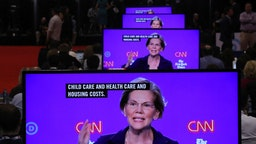 Sen. Elizabeth Warren (D-MA) appear on television screens in the Media Center during the Democratic Presidential Debate at Otterbein University on October 15, 2019 in Westerville, Ohio. A record 12 presidential hopefuls are participating in the debate hosted by CNN and The New York Times. (Photo by Chip Somodevilla/Getty Images)