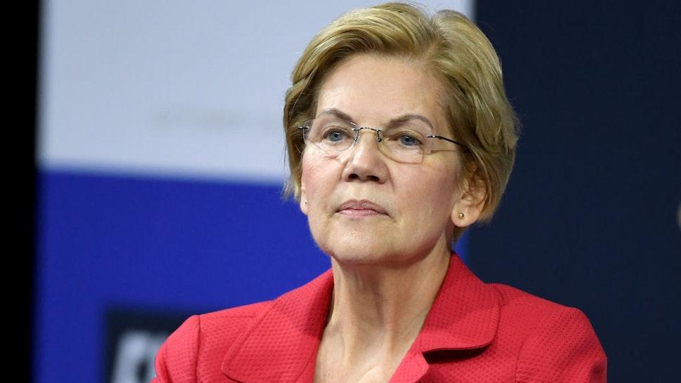 Sen. Elizabeth Warren listens to a question from an audience member during the 2020 Gun Safety Forum