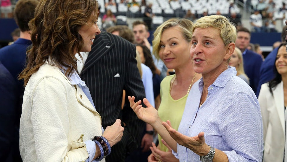 Charlotte Jones-Anderson visits with Ellen DeGeneres and Portia de Rossi before the game between the Green Bay Packers and Dallas Cowboys at AT&T Stadium on October 06, 2019 in Arlington, Texas. (Photo by Richard Rodriguez/Getty Images)