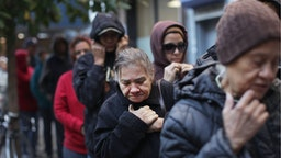 People wait in line to receive free milk from the Milk from the Heart program which makes weekly deliveries to Washington Heights and 12 other locations in Manhattan and the Bronx on October 6, 2011 in New York City.
