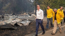 Gov. Gavin Newsom tours a home destroyed in the Kincade Fire, Friday, Oct. 25, 2019, in Geyserville, Calif. (Karl Mondon/MediaNews Group/The Mercury News via Getty Images)