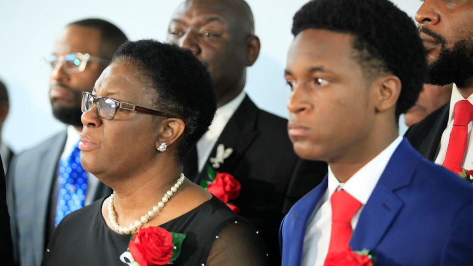 Allison Jean, mother of Botham Shem Jean, stands with family and church members of Greenville Avenue Church of Christ after the funeral service on September 13, 2018 in Richardson, Texas.