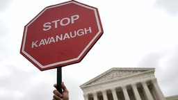 "A ""STOP KAVANAUGH"" sign is seen during a protest against the confirmation of Supreme Court nominee Judge Brett Kavanaugh, outside of the Supreme Court, October 6, 2018 in Washington, DC. The Senate is set to hold a final vote Saturday evening to confirm the nomination of Judge Brett Kavanaugh to the U.S. Supreme Court."