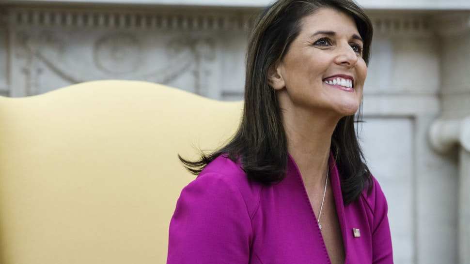 Nikki Haley, U.S. Ambassador to the United Nations, smiles during a meeting with U.S. President Donald Trump, not pictured, in the Oval Office at the White House in Washington, D.C., U.S., on Tuesday, Oct. 9, 2018. Haley will leave her job as U.S. ambassador to the United Nations at the end of the year, Trump said, an announcement that surprised the White House and led to fresh speculation about her political future.