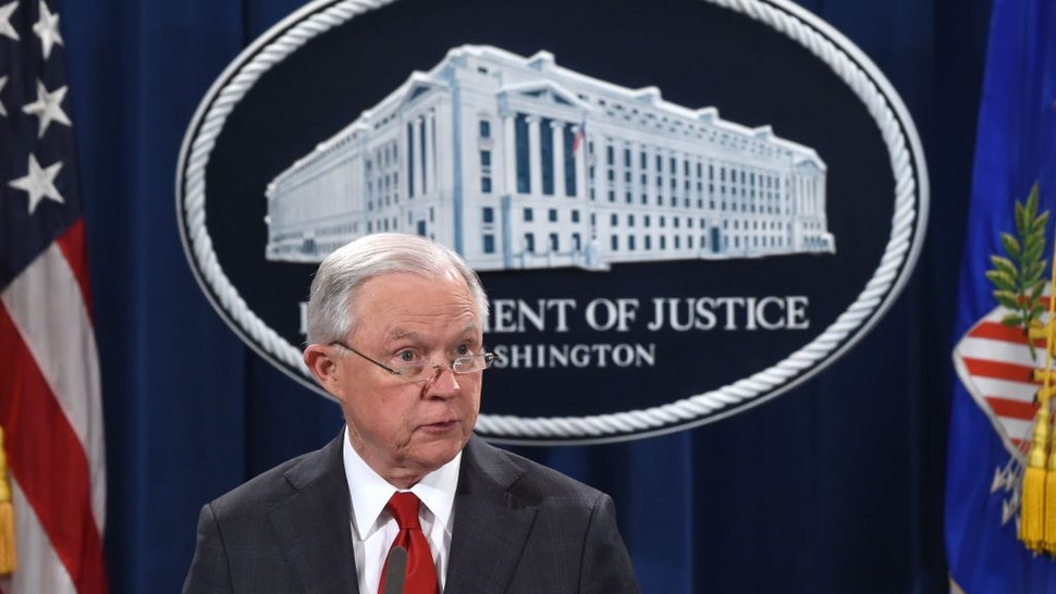 US Attorney General Jeff Sessions speaks during a press conference regarding the arrest of bombing suspect Cesar Sayoc in Florida, at the Department of Justice in Washington, DC on October 26, 2018. - The suspect has been charged with five federal crimes in connection with more than a dozen suspicious packages sent in a US mail bombing spree, Sessions said Friday.