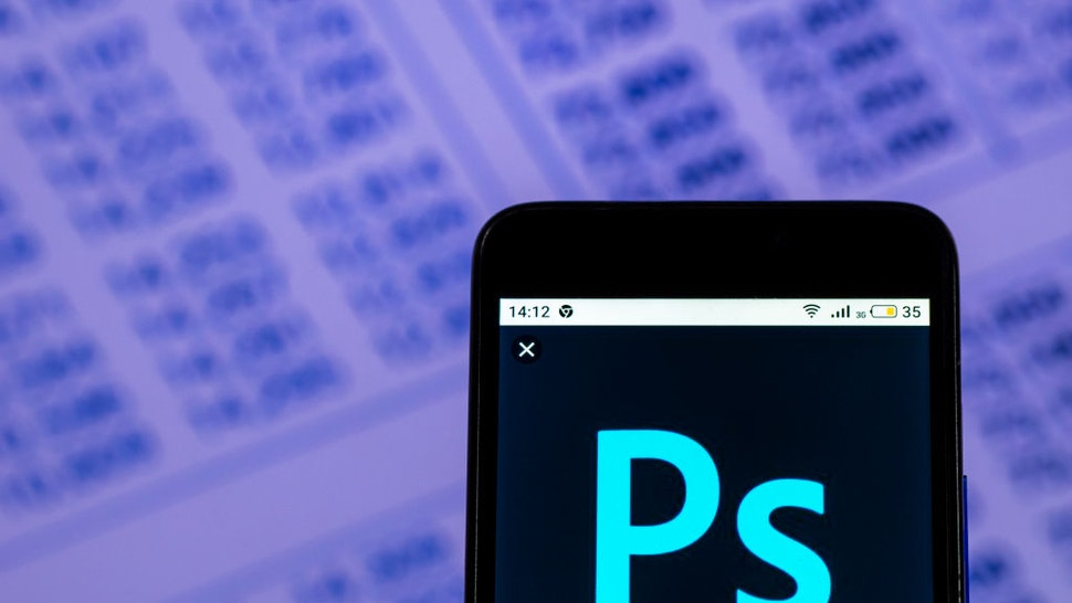 In this photo illustration, the Adobe Photoshop Downloadable software logo seen displayed on a smartphone.