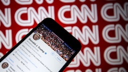 Donald Trump's Twitter profile is seen on a smartphone against a backdrop with the CNN logo, in Ankara, Turkey on December 9, 2018.
