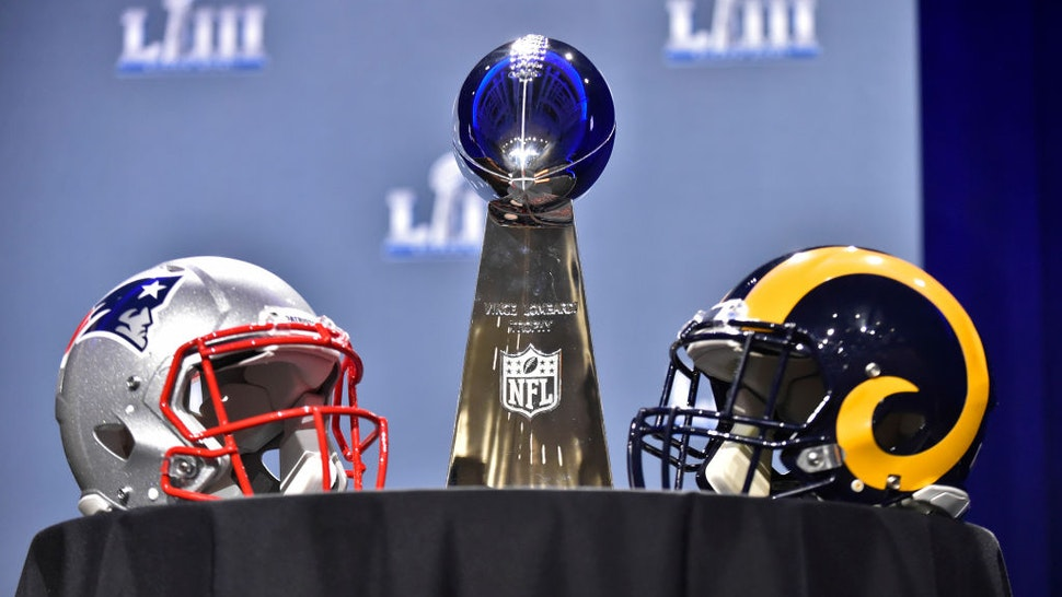 The Vince Lombardi Trophy sits on a table between the New England Patriots and Los Angeles Rams helmets prior to NFL Commissioner Roger Goodell's press conference at the Georgia World Congress Center on January 30, 2019, in Atlanta, GA.