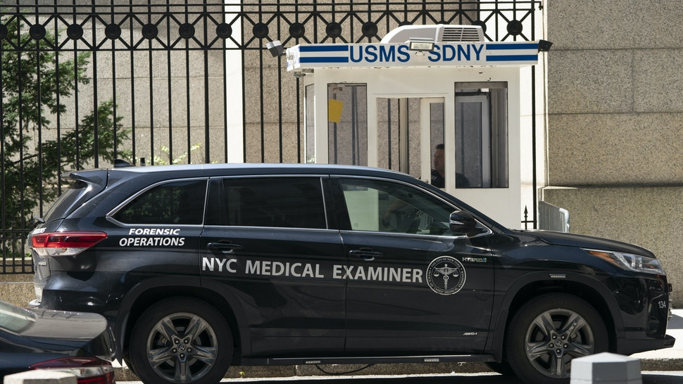 """A New York Medical Examiner's car is parked outside the Metropolitan Correctional Center where financier Jeffrey Epstein was being held, on August 10, 2019, in New York. - Epstein has committed suicide in prison while awaiting trial on charges that he trafficked underage girls for sex, officials and media reported Saturday, sparking an FBI investigation. Epstein, a convicted pedophile who befriended numerous politicians and celebrities over the years, was found unresponsive in his cell at the Metropolitan Correctional Center from """"an apparent suicide"""", the US Department of Justice said. (Photo by Don Emmert / AFP) (Photo credit should read DON EMMERT/AFP/Getty Images)"""