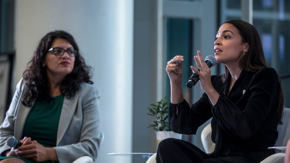 """ep. Alexandria Ocasio-Cortez (D-NY) speaks during a town hall hosted by the NAACP on September 11, 2019 in Washington, DC. Also pictured is Rep. Rashida Tlaib (D-MI). The congresswomen talked about their backgrounds and how they were disruptors who """"challenged conventional wisdom and assumptions"""" about how to get elected, among other topics."""