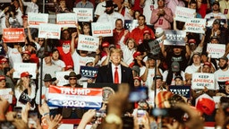 U.S. President Donald Trump, center, smiles during a rally in Rio Rancho, New Mexico, U.S., on Monday, Sept. 16, 2019.