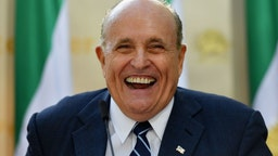 """Rudy Giuliani, Former Mayor of New York City speaks to the Organization of Iranian American Communities during their march to urge """"recognition of the Iranian people's right for regime change,"""" outside the United Nations Headquarters in New York on September 24, 2019. - They urged recognition of the Iranian people's right for regime change and declared their support for the leader of democratic opposition, Maryam Rajavi."""