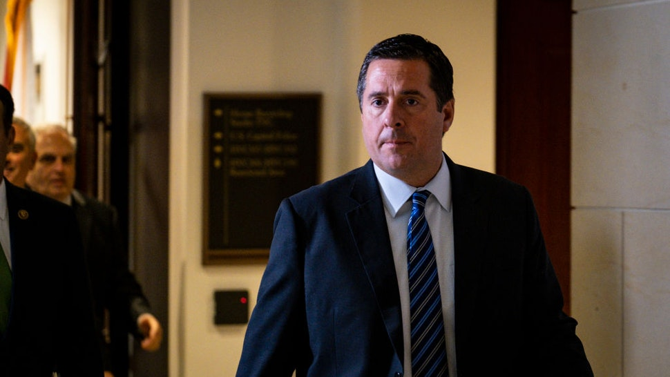 Rep. Devin Nunes (R-CA) walks past the media without comment after leaving a closed door briefing with Intelligence Community Inspector General Michael Atkinson before the House Intelligence Committee on October 4, 2019 in Washington, DC.