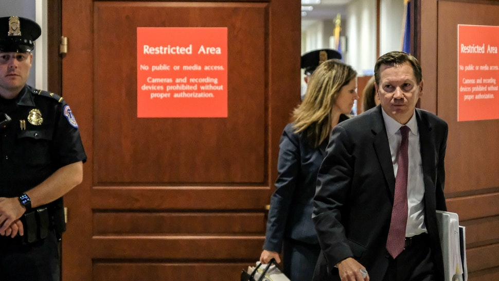 Intelligence Community Inspector General Michael Atkinson, right, leaves a closed briefing with the House Intelligence Committee on Capitol Hill in Washington, D.C., U.S., on Friday, Oct. 4, 2019.