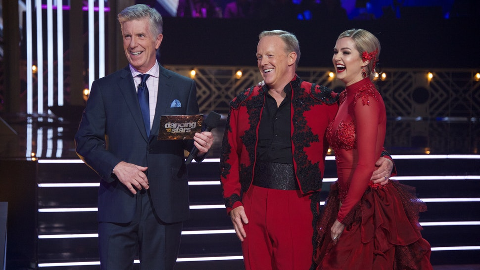 """DANCING WITH THE STARS - """"Top 10"""" - It's another week of competition as 10 celebrity and pro-dancer couples compete on the fourth week of the 2019 season of """"Dancing with the Stars,"""" live, MONDAY, OCT. 7 (8:00-10:00 p.m. EDT), on ABC. (Eric McCandless via Getty Images) TOM BERGERON, SEAN SPICER, LINDSAY ARNOLD"""