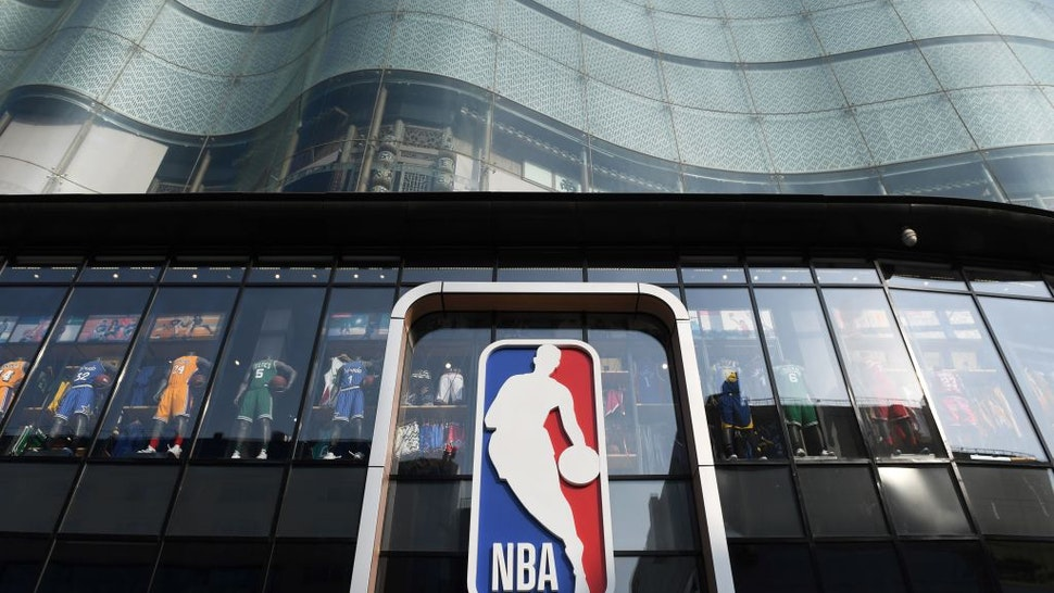 "The National Basketball Association (NBA) store is seen in Beijing on October 9, 2019. - Chinese state media slammed the NBA for an ""about-face"" on October 9 after the body said it would not apologise for a tweet by the Houston Rockets General Manager supporting pro-democracy protests in Hong Kong."