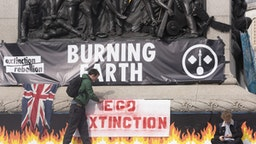 Environmentalist group 'Extinction Rebellion' continues to stage protests in second day occupying central locations including Trafalgar Square, Victoria Street, Parliament Street in London, United Kingdom on October 9, 2019. Metropolitan police cleared a number of locations from protesters by arresting more than 600 of them since yesterday. (Photo by Ray Tang/Anadolu Agency via Getty Images)