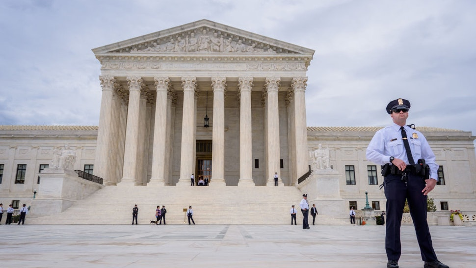 WASHINGTON DC, UNITED STATES - 2019/10/08: A police officer guarding outside the Supreme Court of the United States in Washington, DC.