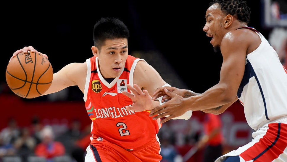 WASHINGTON, DC - OCTOBER 09: Ying-Chun Chen #2 of the Guangzhou Long-Lions drives against Justin Robinson #5 of the Washington Wizards during the first half at Capital One Arena on October 9, 2019 in Washington, DC.