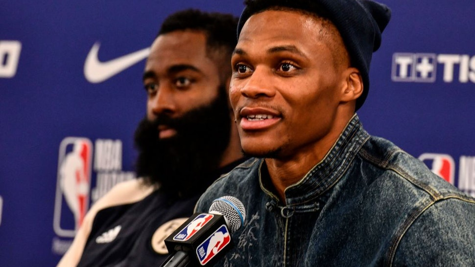 Houston's guard Russel Westbrook (R) answers questions beside James Harden (L) during a press conference after the NBA Japan Games 2019 pre-season basketball match between Houston Rockets and Toronto Raptors in Saitama, northern suburb of Tokyo on October 10, 2019.