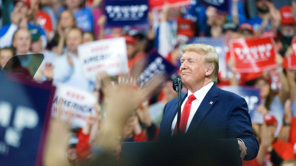 """U.S. President Donald Trump reacts during a rally in Minneapolis, Minnesota, U.S., on Thursday, Oct. 10, 2019. Trumpsaid the first day of high-level trade negotiations between the U.S. and China on Thursday went """"very well"""" and that he plans to meet with the top Chinese negotiator Friday."""