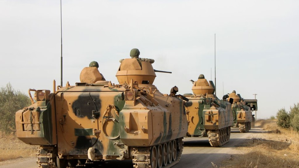 Turkish soldiers are trasported in armoured personnel carriers through the town of Tukhar, north of Syria's northern city of Manbij, on October 14, 2019, as Turkey and it's allies continues their assault on Kurdish-held border towns in northeastern Syria. - Turkey wants to create a roughly 30-kilometre (20-mile) buffer zone along its border to keep Kurdish forces at bay and also to send back some of the 3.6 million Syrian refugees it hosts.