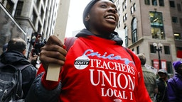 TCHICAGO, Oct. 17, 2019 -- A teacher takes part in the Chicago Teachers' Union strike rally in downtown Chicago, the United States, on Oct. 17, 2019. Thousands of teachers and supporters rally on Thursday after Chicago Teachers' Union failed to make a deal with the municipal government on raising the teachers' salaries. (Photo by Joel Lerner/Xinhua via Getty) (Xinhua/ via Getty Images)