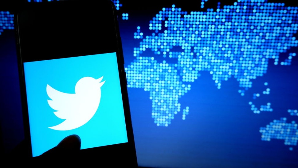 In this photo illustration a popular micro blogging and social networking service Twitter logo displayed on a smartphone.
