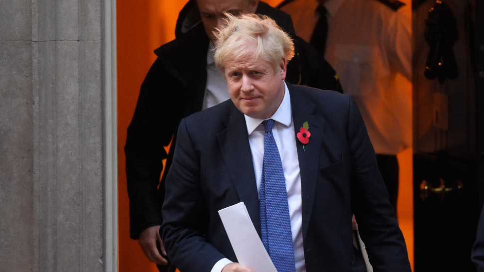 LONDON, ENGLAND - OCTOBER 28: Prime Minister Boris Johnson and his political advisor Dominic Cummings leave 10 Downing Street on October 28, 2019 in London, England. EU leaders have announced that an agreement to extend Brexit until 31 January 2020 has been agreed in principle.