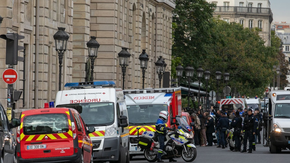 Journalists gather near Paris Police headquarters after four officers were killed in a knife attack on October 3, 2019 in Paris, France. A civilian police worker wielding a knife stabbed and killed four officers at the police headquarters before being shot dead.