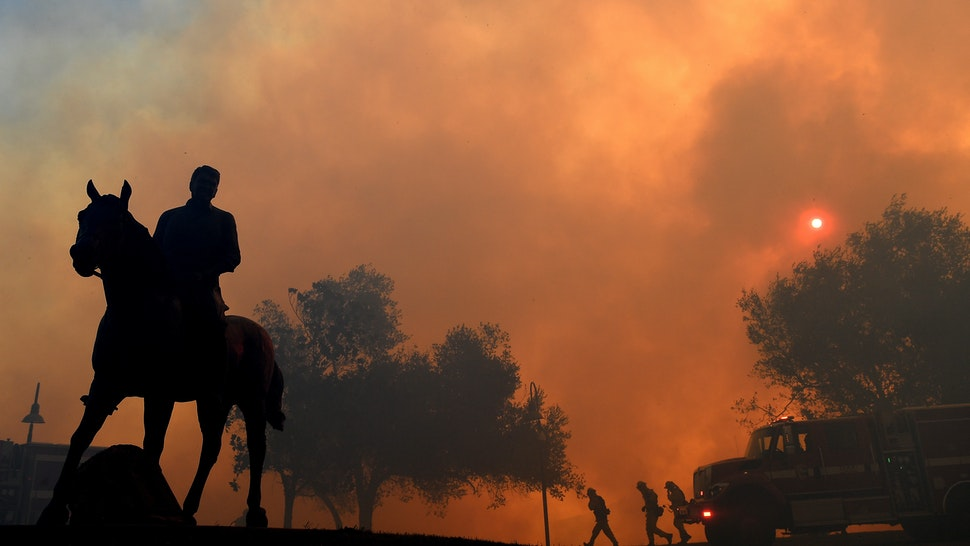"""SIMI VALLEY, CALIFORNIA - OCTOBER 30: A statue of former U.S. President Ronald Reagan titled """"Along The Trail"""" stands outside the Reagan Presidential Library as the Easy Fire burns on October 30, 2019 in Simi Valley, California. (Photo by Wally Skalij/Los Angeles Times via Getty Images)"""