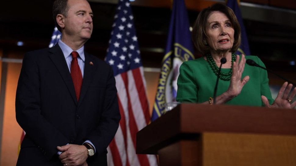 WASHINGTON, DC - OCTOBER 15: U.S. Speaker of the House Rep. Nancy Pelosi (D-CA) speaks as Chairman of House Intelligence Committee Rep. Adam Schiff (D-CA) listens during a news conference at the U.S. Capitol October 15, 2019 in Washington, DC. Pelosi said she is holding off on a full House vote to authorize an impeachment inquiry against President Donald Trump.