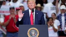 "U.S. President Donald Trump speaks during a ""Keep America Great"" Campaign Rally at American Airlines Center on October 17, 2019 in Dallas, Texas. (Photo by Tom Pennington/Getty Images)"