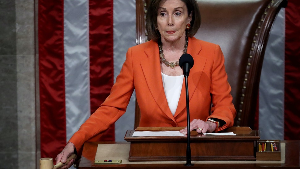 Speaker of the House Nancy Pelosi (D-CA) gavels the close of a vote by the U.S. House of Representatives on a resolution formalizing the impeachment inquiry centered on U.S. President Donald Trump October 31, 2019 in Washington, DC. The resolution, passed by a vote of 232-196, creates the legal framework for public hearings, procedures for the White House to respond to evidence and the process for consideration of future articles of impeachment by the full House of Representatives. (Photo by Win McNamee/Getty Images)